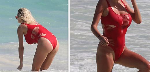 A facut furori la plaja intr-un costum de baie rosu si decupat! Ce vedeta a fost fotografiata de paparazzi in ipostaze hot