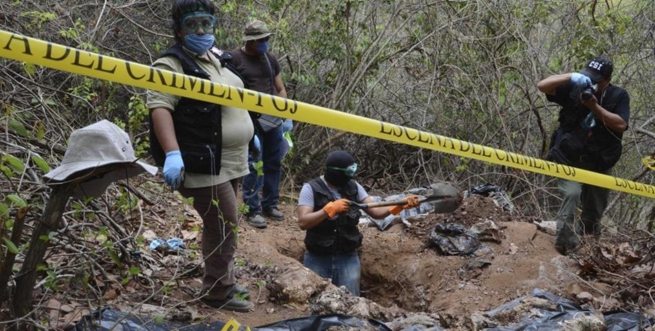 Groaznic! S-au descoperit 19 cadavre intr-o groapa comuna