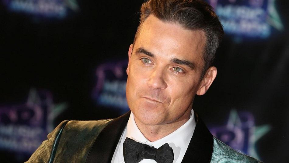 Robbie Williams n-a iesit trei ani din casa, de frica